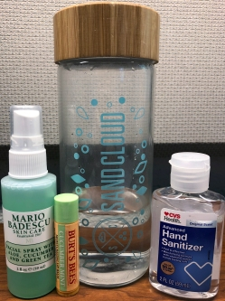 A photo of Mario Badescu aloe, cucumber, and green tea facial spray, burt's bees cucumber mint chapstick, a sandcloud water bottle, and cvs hand sanitizer