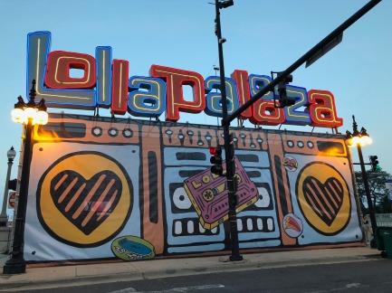 A photo of the entrance to Lollapalooza. A artsy cartoon boombox.